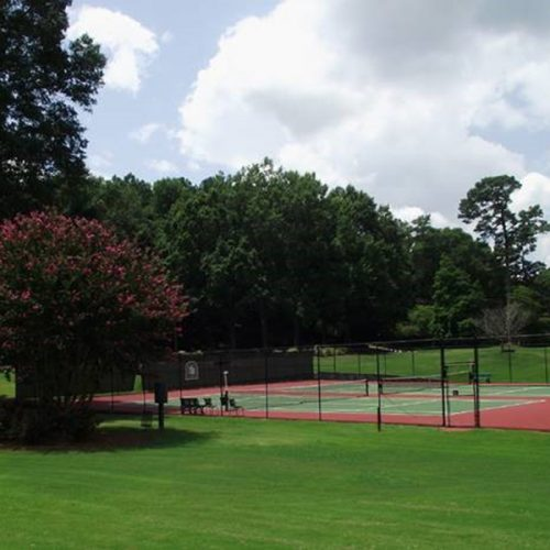 Tennis court landscaped by SKB Industries