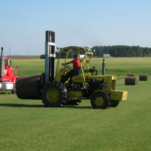 tractor with bale of sod